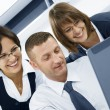 Portrait of young business discussing project in office environment — Stock Photo #14293623