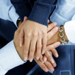 Close up view of hands getting together in office environment — Stock Photo
