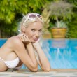 Portrait of young attractive woman having good time in tropic environment - Stock Photo