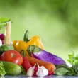Close up view of nice fresh vegetables on green summer back — Stock Photo #14296973