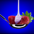 Close up view of nice fresh strawberry on blue back - Stock Photo
