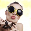 Portrait of young gorgeous woman in funky yellow sunglasses — Stock Photo #14322137