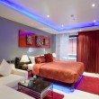 Panoramic view of nice stylish modern bedroom. - Stock Photo