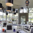 Panoramic view of nice modern stylish restaurant interior - Stock Photo