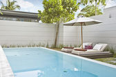 Image of nice modern summer patio with swimming pool — Stock Photo