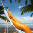 Stock Photo: View of nice smooth womans legs in tropical bliss