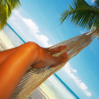 View of nice smooth womans legs in tropical bliss — Stock Photo