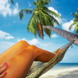 View of nice smooth womans legs in tropical bliss — Stock Photo #25908329