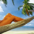 View of nice smooth womans legs in tropical bliss — Stock Photo #25909331
