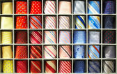 View of different colors ties in the showcase — Stock Photo