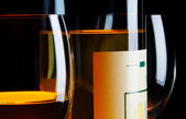 View of bottle of white wine and wineglasses beside — Stock Photo