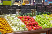 View of supermarket showcase full of nice tropical fruits — Stock Photo