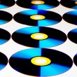 View of compact discs on white sheet — Stock Photo