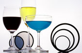 View of three different sizes wineglasses and some figure on white sheet — Stock Photo