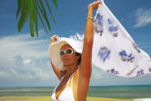 Portrait of nice woman in white panama and sunglasses in tropical environment — Stock Photo
