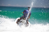 View of jetski rider fiercely struggling with ocean wave — Stock Photo