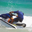 Stock Photo: View of jetski rider fiercely struggling with ocewave