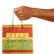 View of humans hand presenting some birthday gift — Foto de Stock