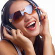 Young beautiful happy women listening music in headphones — Stockfoto