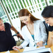 View of Workgroup interacting in natural work environment — Stock Photo #25956005