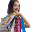 Portrait of young cute brunette with colorful paper bags — Stock Photo #25958919