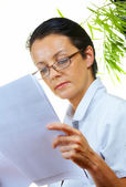 Portrait of businesswoman doing her paperwork in the office — Stock Photo