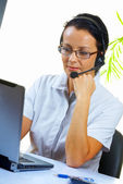 Nice operator in stylish glasses at her working place — Stock Photo
