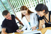 View of Workgroup interacting in a natural work environment — Stock Photo