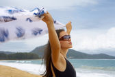 View of nice young woman with wind-blowing sarong — Stock Photo