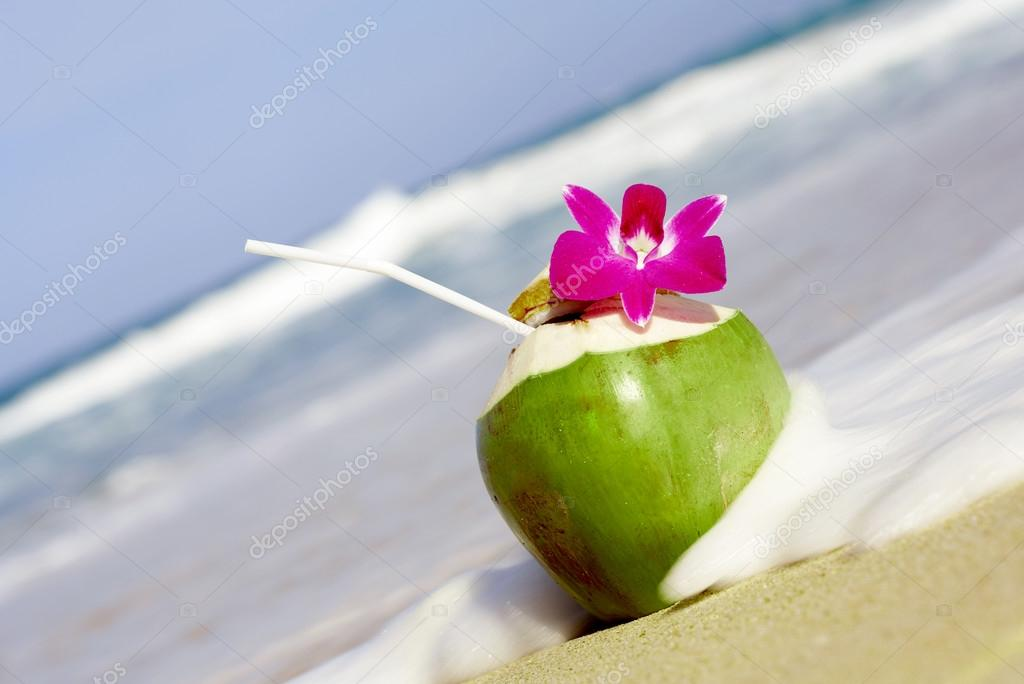 View Of Nice Fresh Tropic Cocktail Decorated With Orchid