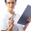 Stock Photo: Portrait of businesswomin stylish glasses with clipboard on white back.