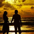 Stock Photo: View of young couple canoodling fondly during sunset
