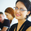 Portrait of young pretty woman in business environment — Foto de Stock