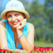 Portrait of young beautiful woman in colorful hat in summer environment — Stock Photo #25963723