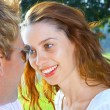 A portrait of attractive couple in summer environment — Stock Photo #25965841