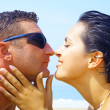 Portrait of attractive couple having fun on beach — Stock Photo #25968317