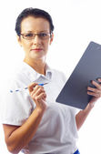 Portrait of businesswoman in stylish glasses with clipboard on white back. — Stock Photo