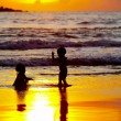 view of two kids bathing during nice colorful sunset — Stock Photo
