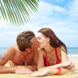 Portrait of attractive couple having date on the beach — Stock Photo #25978011