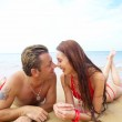 Portrait of attractive couple having date on the beach — Stock Photo #25978159