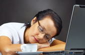 Portrait of a woman dozing on her working place — Stock Photo