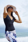 View of nice young lady in white panama and sunglasses — Stock Photo