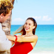 Portrait of attractive couple having date on the beach — Stock Photo #25981067