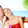 Portrait of attractive couple having date on the beach — Stock Photo #25983701
