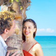 Stock Photo: Portrait of attractive couple having date on the beach