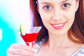 High-key portrait of young woman with cocktail in multicolor back lights. Image may contain slight multicolor aberration as a part of design — Stock Photo