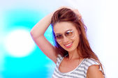 High-key portrait of young smiling woman on color back. Image may contain slight multicolor aberration as a part of design. — Stock Photo