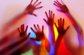 Silhouette of hands on colorful back. Image may contain slight multicolor aberration as a part of design — Stock Photo