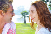 Portrait of attractive couple having date on the beach — Stock Photo