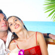 Portrait of attractive couple having date on the beach — Stock Photo #25992383